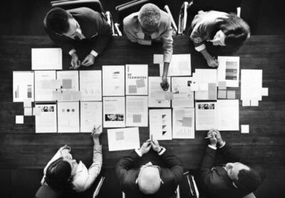business people analyzing statistics